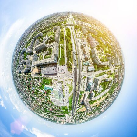Aerial city view with crossroads and roads, houses, buildings, parks and parking lots, bridges. Helicopter drone shot. Wide Panoramic image. 写真素材