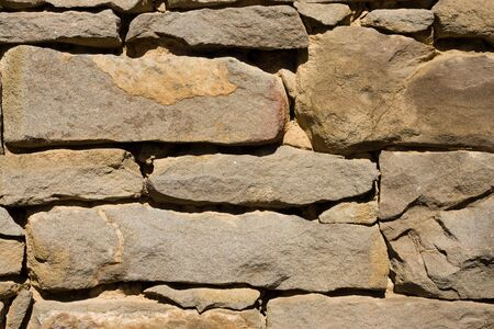 High stone wall, details visible