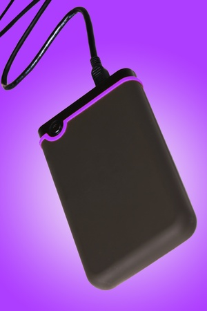 External Hard Drive pluged in Stock Photo