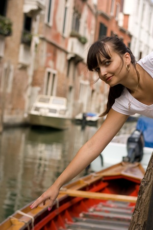 Portrait of a beautiful young woman in Venice. This image is shot with selective focus, processed from 16-bit Pro RGB. Stock Photo
