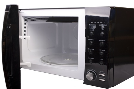 Microwave oven open and isolated on white