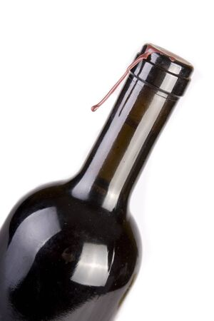 Unopened bottled of red wine isolated on white