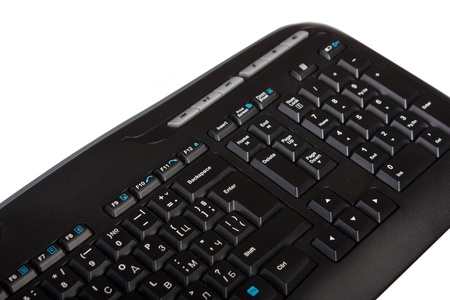 Computer keyboard isolated on white. Selective focus on the enter button. photo