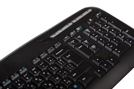 Tastiera del computer isolato su bianco. Fuoco sul pulsante di invio. Archivio Fotografico