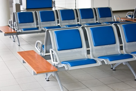 Seats with no people on the airport. photo