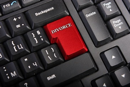 Keyboard with selective focus on the enter button saying DIVORCE Stock Photo - 8538873