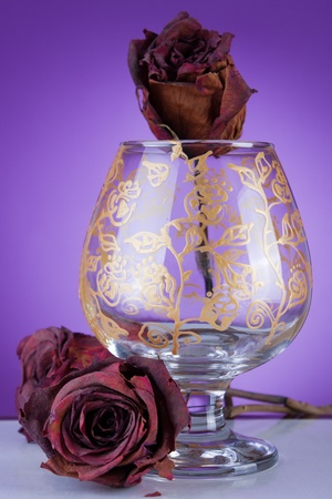 Design glass decorated in gold on purple background