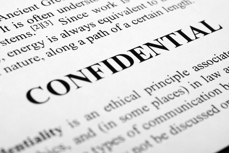 The word confidential shot with artistic selective focus.
