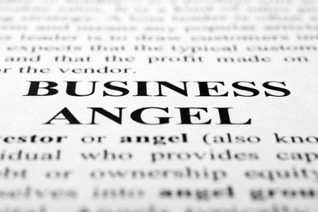 The words business angel shot with artistic selective focus.