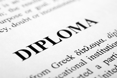 western script: The word diploma shot with artistic selective focus.