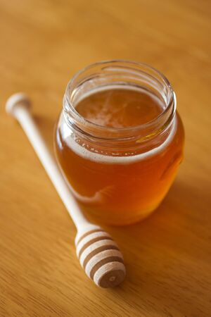 Real honey in a jar. Artistic selective focus. Stock Photo - 11396773
