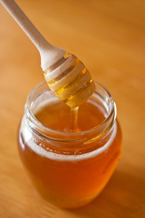Real honey in a jar. Artistic selective focus. Stock Photo - 11396755
