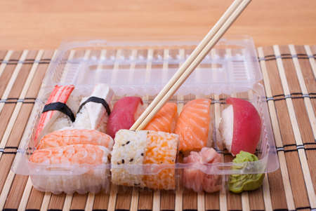 Sushi set of cups and chopstick. Selective focus.