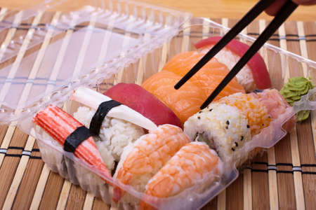 Sushi set of cups and chopstick. Selective focus. Stock Photo - 11641304