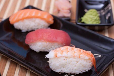 Fish sushi set on sushi plate. Selective focus.