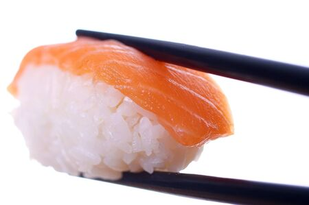 Single sushi on white. Artistic selective focus.