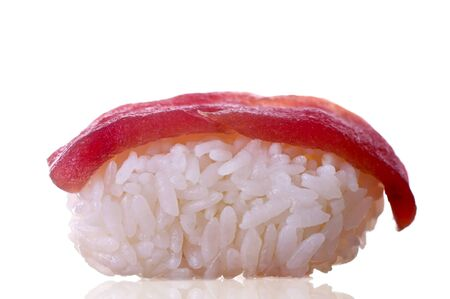 Single sushi on white. Artistic selective focus.