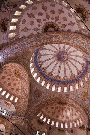 Blue Mosque in istanbul - ceiling detail with floral and geometrical interior decoration, calligraphy art of Koranic verses.