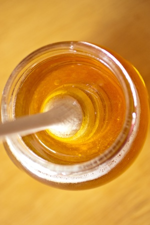Real honey in a jar. Artistic selective focus. Stock Photo