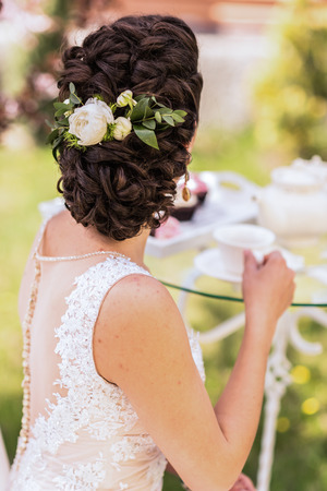 flower of live: wedding bride hairstyle with a live flower Stock Photo