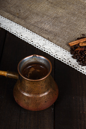 turk: black coffee in turk with cinnamon and star anise
