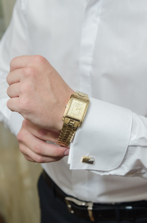 suit  cuff: the man in the white shirt buttons watch Stock Photo