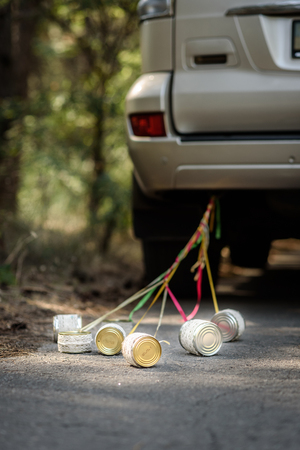 tin cans: tin cans tied with ribbons for the wedding car