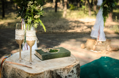 wedding ceremony in the woods among the trees on the green track