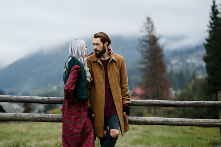 sexual foreplay: pair of lovers in the Carpathian mountains in national costumes Stock Photo