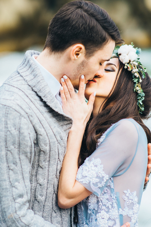 passionate lovers: the bride kisses the groom, the passionate kiss of lovers