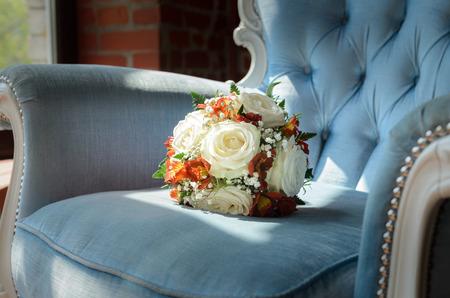 antique chair: Bridal bouquet in soft antique chair from blue velvet