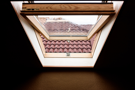 attic window: open wooden attic window overlooking the street
