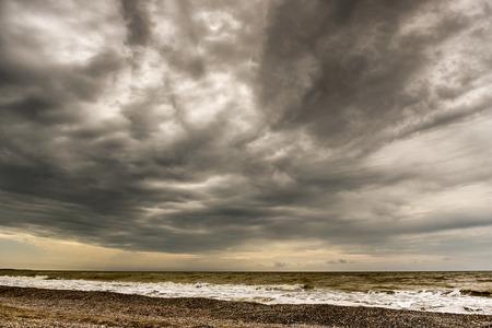sullen: sullen red sea covered in a thick dark clouds