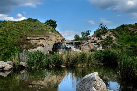 flooded industrial granite career with waterfalls