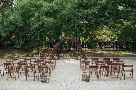 wedding ceremony area, arch chairs decor