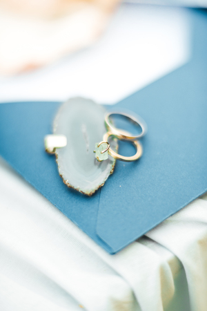 gold wedding rings on the sea shell
