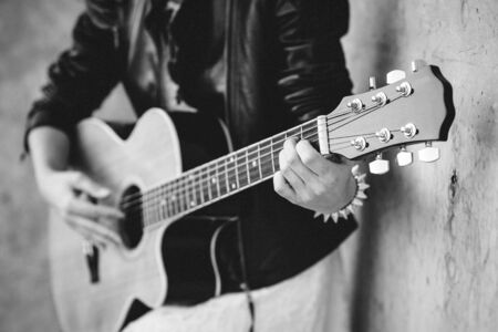 musician young girl with red hair with an acoustic guitar
