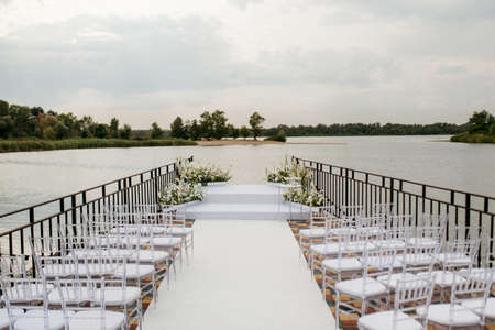 area for the wedding ceremony, on a stone pier near the water