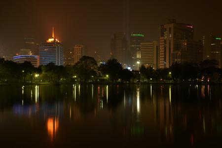 lumpini: Night view of Bangkok from Lumpini Park, Bangkok, Thailand  Stock Photo