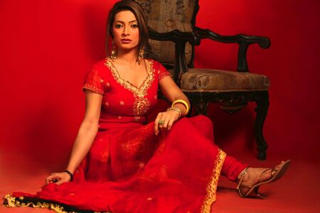 Beautiful Asian girl in Red traditional dress photo