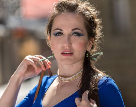 Portrate of beautiful young woman with brown eyes in outside
