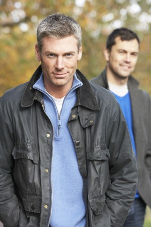 Two Men Standing Outside In Autumn Woodland photo