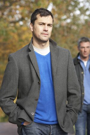 fourties: Two Men Standing Outside In Autumn Woodland
