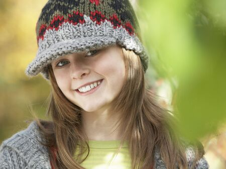 Head And Shoulders Of Young Girl In Autumn Woodland  Foto de archivo