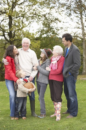 Extended Family Group On Walk Through Countryside photo