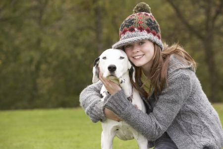 Young Girl Talking Dog For Walk photo