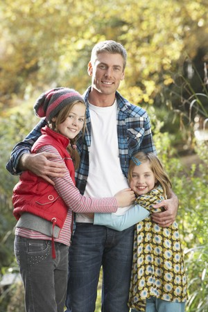 Father And Children Standing Outdoors On Wooden Walkway In Autumn Landscape Stock Photo - 7172036
