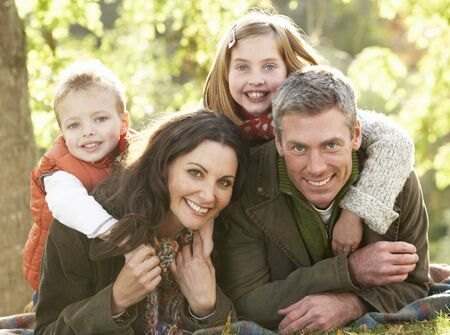 countryside loving: Family Group Relaxing Outdoors In Autumn Landscape