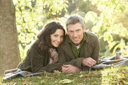 Romantic Couple Relaxing Outdoors In Autumn Landscape Stock Photo - 7184788