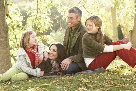 Family Group Relaxing Outdoors In Autumn Landscape Stock Photo - 7185006